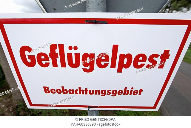 A sign that reads 'Gefluegelpest Beobachtungsgebiet' has been set up in Bippen, Germany, 28 July 2015. According to the Office for Consumer Protection and Food...