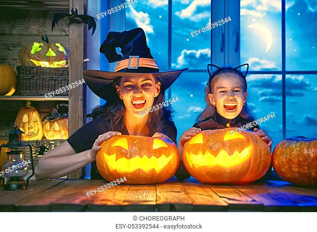 Mother and her daughter having fun at home. Happy Family celebrating for Halloween