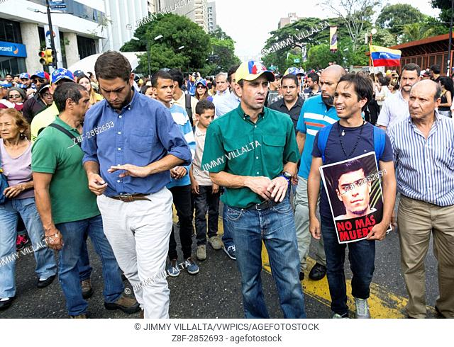 Henrique Capriles Radonski, governor of the Miranda state, and recently politically disabled for 15 years, speaks with a student in homage to the murdered young...