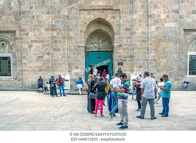 Unidentified people wait in front of Grand Mosque or Ulu Cami is largest mosque in Bursa,Turkey. 20 May 2018