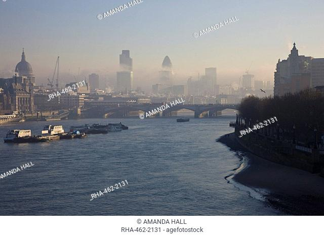 Early morning fog hangs over St. Paul's Cathedral and the City of London, London, England, United Kingdom, Europe