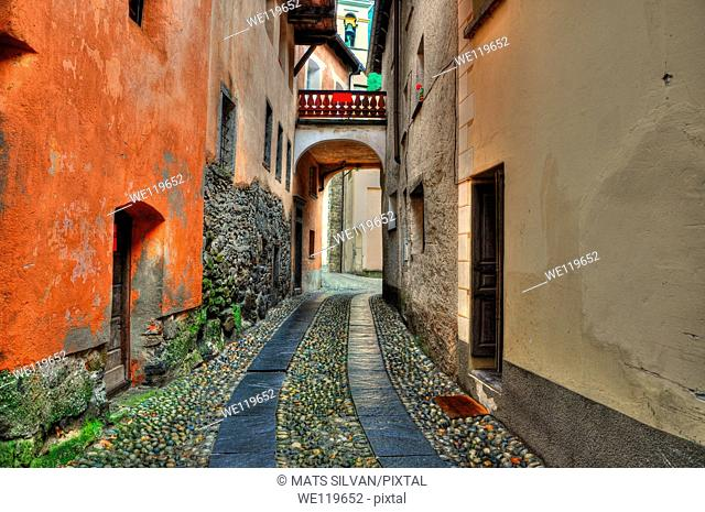 Tight alley with old rustic houses in ticino switzerland