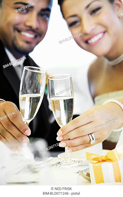 Multi-ethnic bride and groom toasting