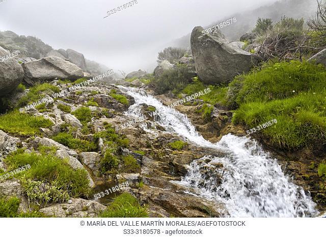 Waterfall and fog at Eliza gorge in the Sierra de Gredos. Avila. Spain
