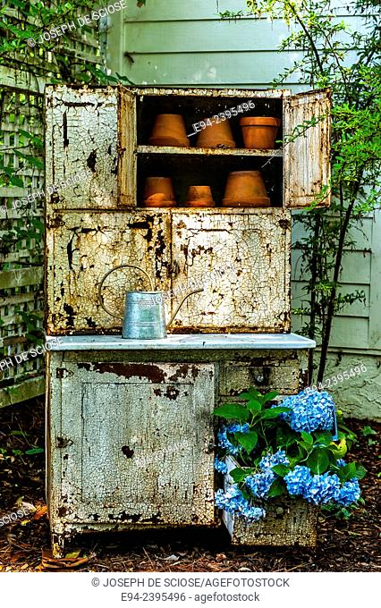 Potting bench in a garden with a flowering hydrangea.Georgia USA
