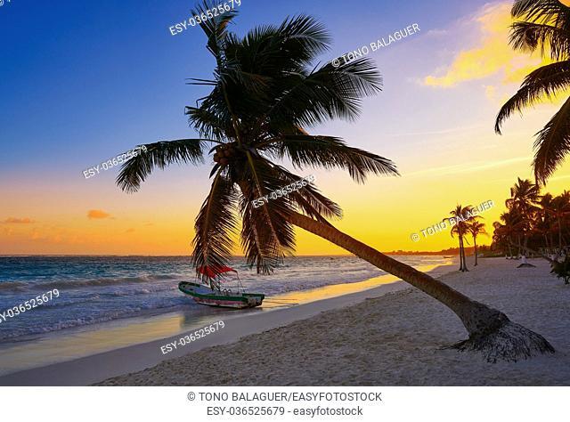 Tulum beach sunset palm tree in Riviera Maya at Mayan Mexico