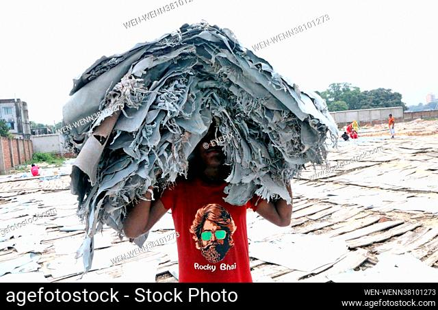 Workers of a tannery from Hazaribagh put leather pieces out to dry on August 26th 2021 in Dhaka, Bangladesh. They were previously painted on wooden boards out...