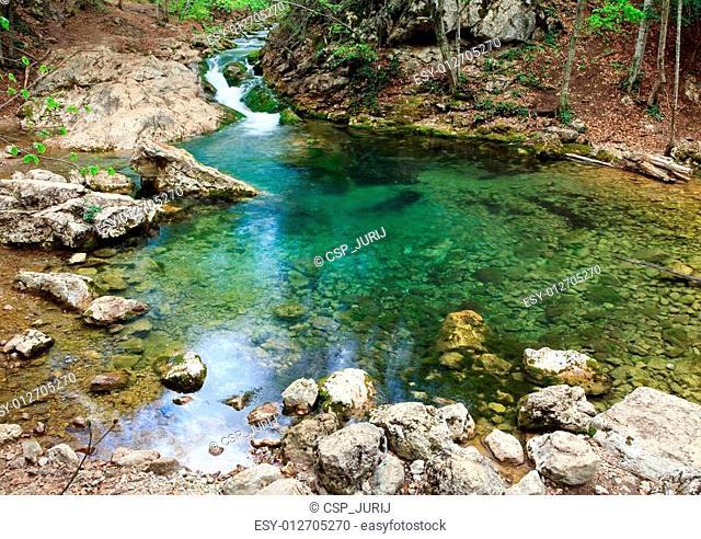 Blue Lake on mountain river