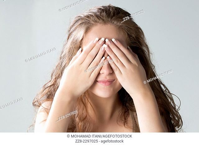 Young woman hands covering eyes