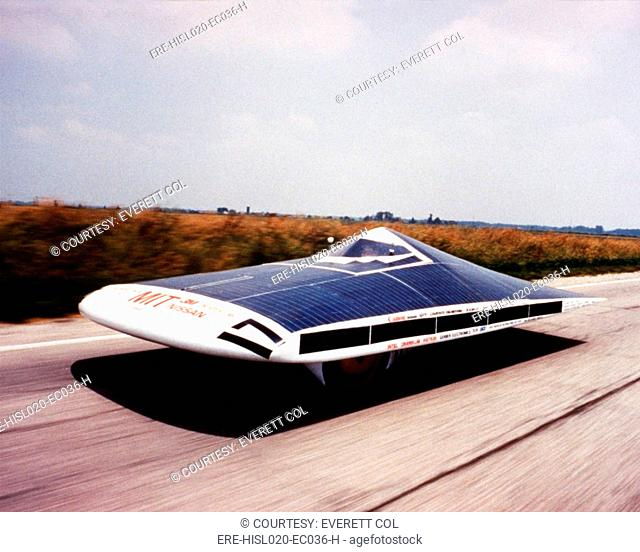 Solar car on the road during the SUNRAYCE 1995 race of experimental solar vehicles from Indianapolis to Golden, Colorado in June 1995