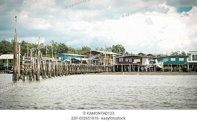 Traditional Thai fishing village along the river and the mangrove in Samutprakarn, Thailand