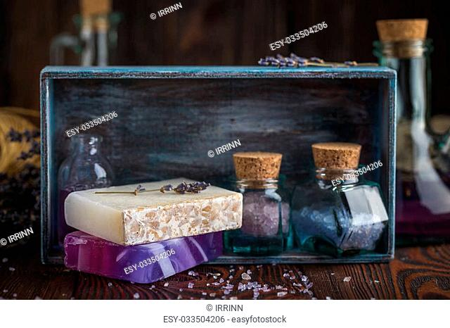 Lavender sea salt, natural organic soaps, lavender oil for massage spa in a wooden box