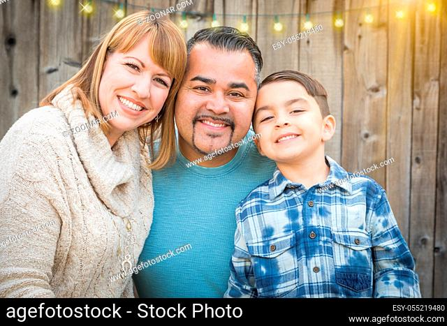Happy Young Mixed Race Family Portrait Outside