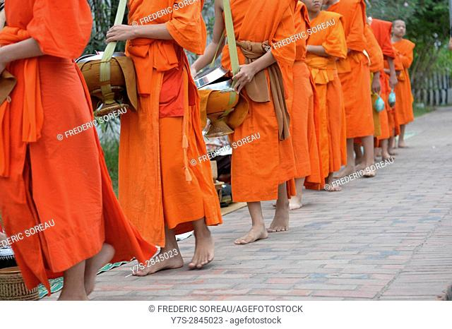 Monks receiving alms at dawn,Luang Prabang,Laos,Southeast Asia