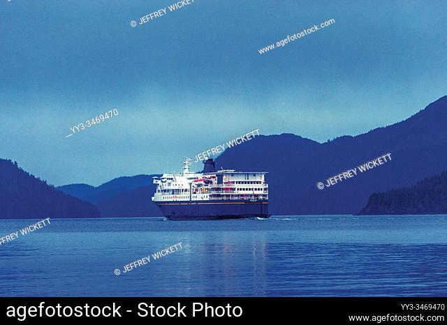 The M/V Kennicott sailing out of the Sitka Terminal. Sitka, Alaska, USA. The Alaska Marine Highway System operates along the south-central coast of the state