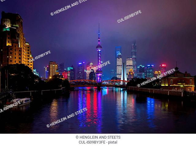 Pudong skyline and Waibaidu Bridge over Huangpu river at night, Shanghai, China