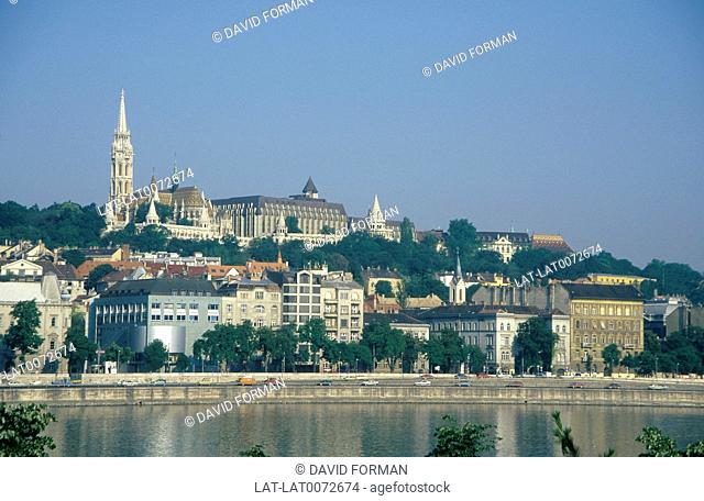 View from Pest to Castle Hill/ Varhegy. St Mattias. Matyas Church and Fisherman's Bastion. Hilton hotel