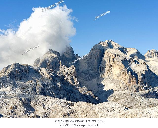 View towards Cimon della Pala, Cima della Vezzana and Focobon. The alpine plateau Altipiano delle Pale di San Martino in the Pala group in the dolomites of the...