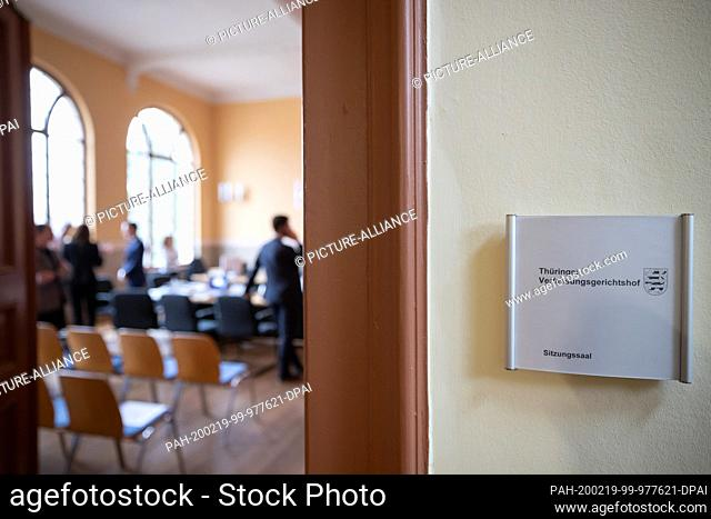 19 February 2020, Thuringia, Weimar: People are standing in the conference room of the Thuringian Constitutional Court, where the complaint of former...