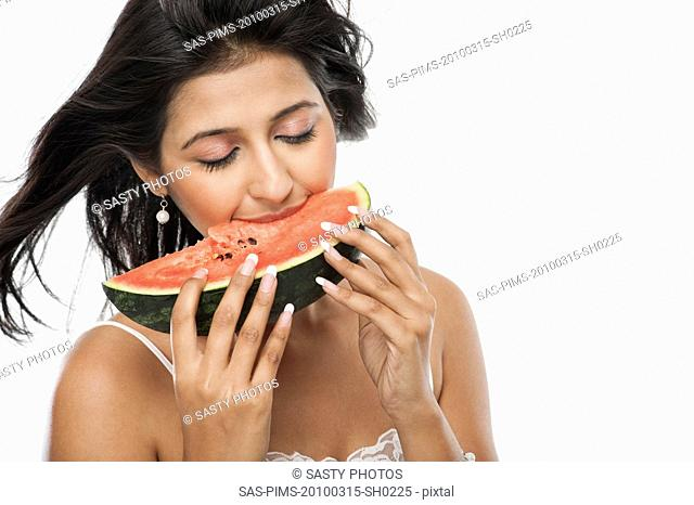Woman eating a slice of watermelon