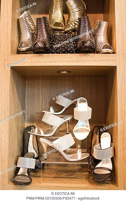 Sandals on display at a shoe store, New Delhi, India