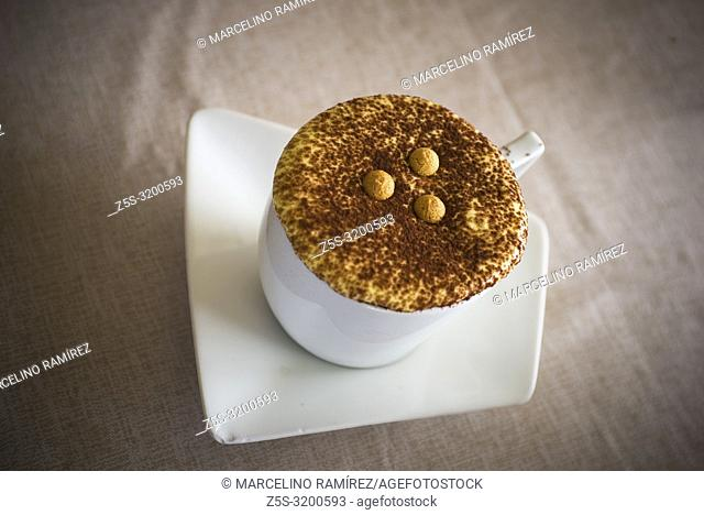 Cup of cappuccino coffee with cacao topping and cookie pearls. Varenna, Province of Lecco, Lombardy, Italy, Europe