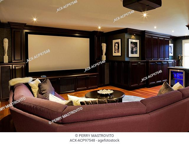 Home theater room with vintage photos of Hollywood satrs on the upstairs floor inside an elegant cottage style home, Quebec, Canada