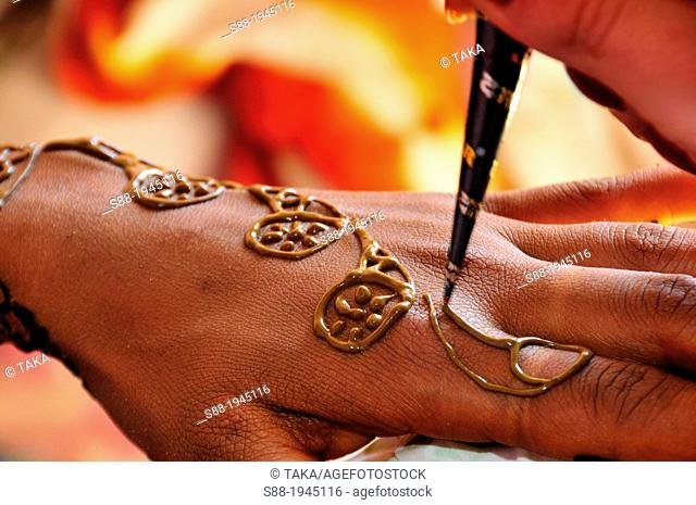 On the day of marriage in the morning, bride having henna painting