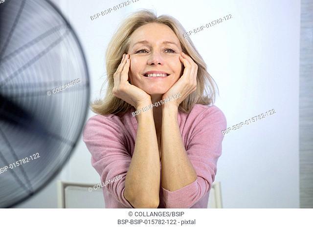 A menopausal woman having a hot flush