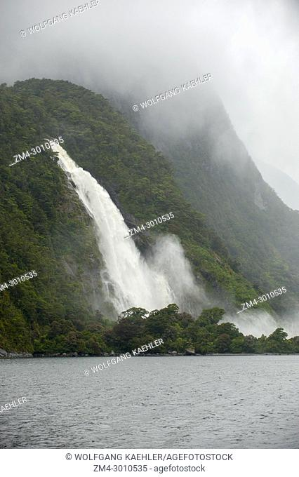 Heavy rain creating waterfalls in Milford Sound, Fjordland National Park on the South Island in New Zealand