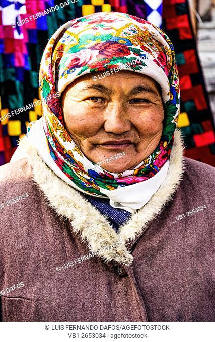 Portrait of old Kyrgyz vendor woman at the big bazaar in Osh, Kyrgyzstan