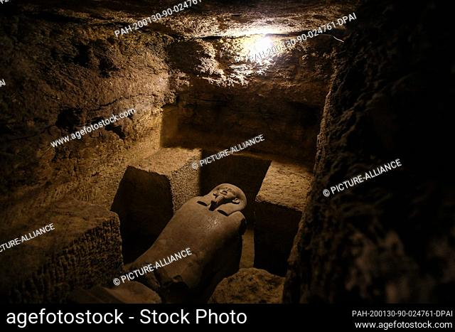 30 January 2020, Egypt, Minya: Asarcophagus is seen inside a communal tomb, one of three newly discovered tombs of the high priests of ancient Egyptian deity...