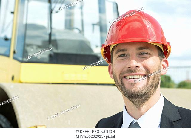 Businessman with hard hat on construction site