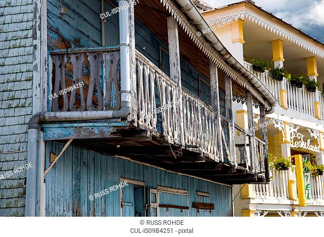 Old traditional painted wooden house with balcony, Reunion Island