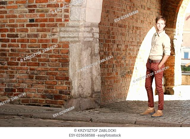 full length young handsome man casual style fashion model posing on street of old town gdansk poland europe