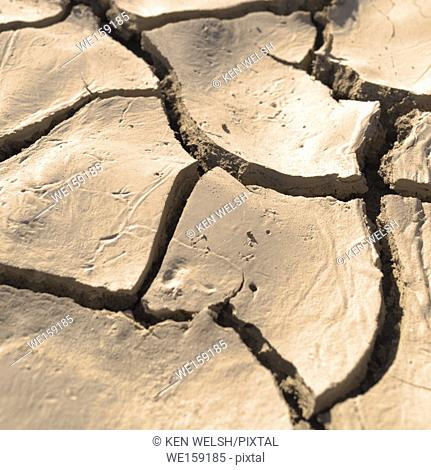 Close up of cracked, dried earth creating an abstract pattern