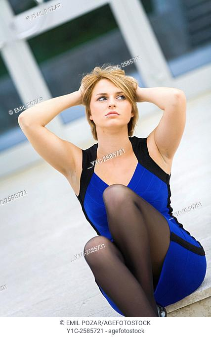 Pretty woman holding head day-dreaming looking up