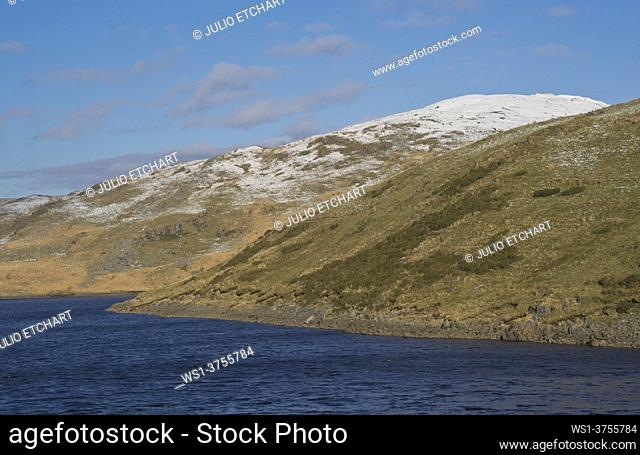 Recervoir surrounded by snow in the winter in the hills in Ceredigion, Wales, UK