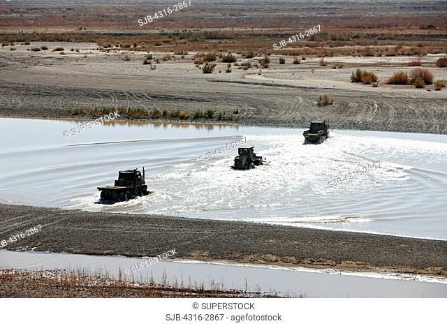 U.S. Marine Corps heavy equipment crosses the Helmand River of southern Afghanistan's Helmand Province