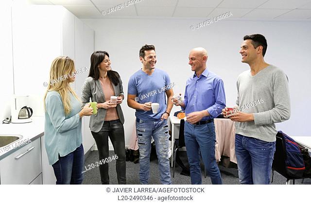 Executives drinking coffee. Break