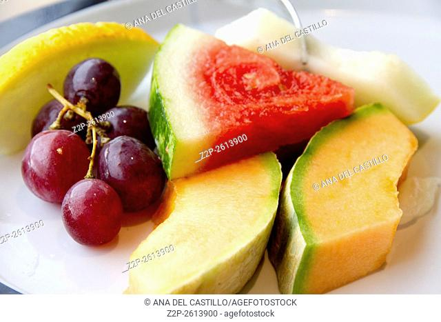fresh various fruits slices on plate