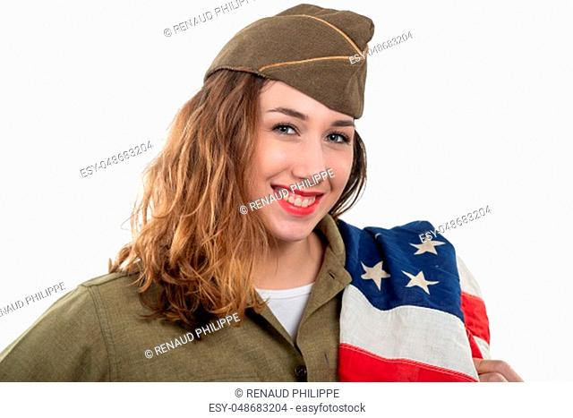 pretty young woman in ww2 uniform us with an american flag