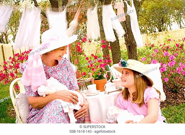 Grandmother talking to her granddaughter