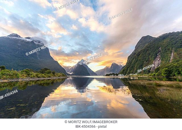 Mitre Peak reflecting in the water, sunset, Milford Sound, Fiordland National Park, Te Anau, Southland Region, Southland, New Zealand