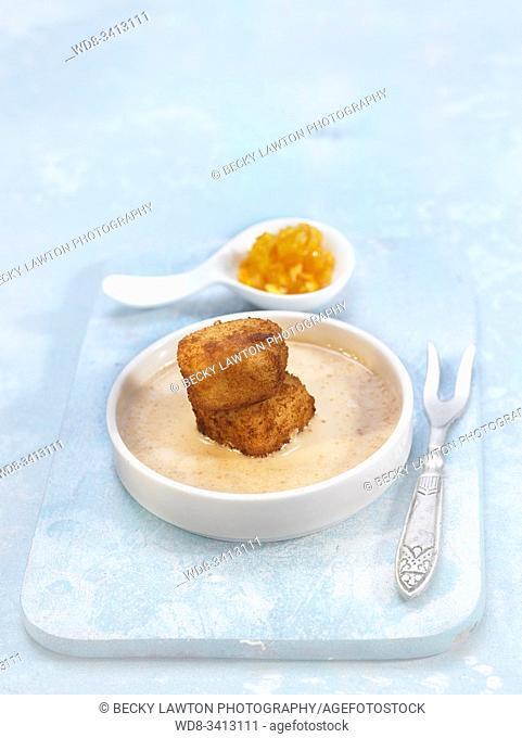 Croquetas de arroz con leche con crema de turrón y naranja caramelizada / Milk rice croquettes with caramelized nougat cream and orange