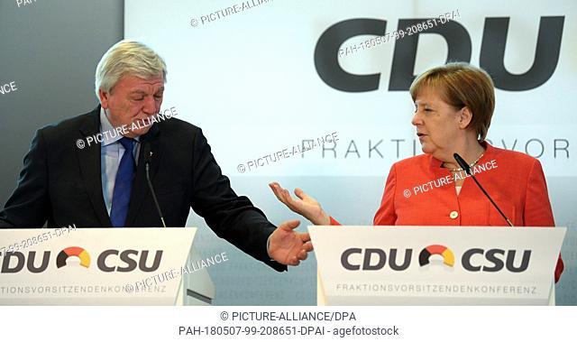 07 May 2018, Germany, Frankfurt am Main: German Chancellor Angela Merkel (CDU) speaking next to Volker Bouffier (CDU), Premier of Hesse