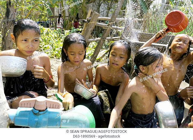CAMBODIA. Projects of DPA in Stung Treng, supported by SCIAF. Phluck village  Children enjoying themselves washing at the well