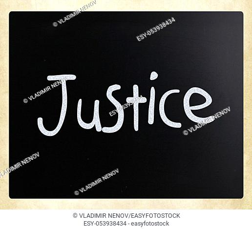 """""""""""Justice"""" handwritten with white chalk on a blackboard"