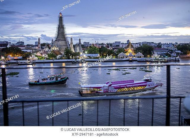 Wat Arun and boats, Chao phraya river, Bangkok, Thailand