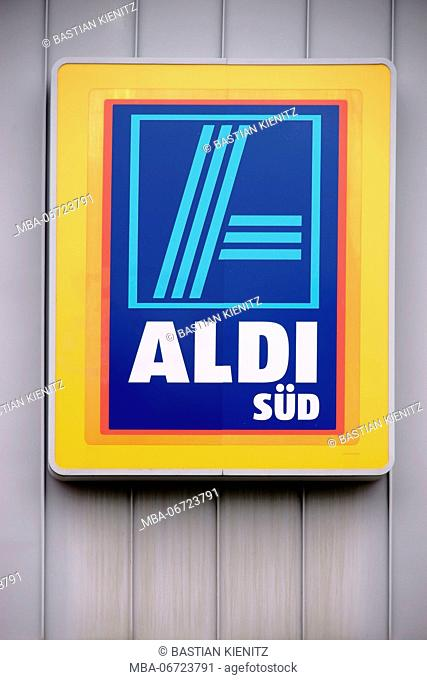 The bright company logo of the food discount shop Aldi Süd at the tin facade of a food market